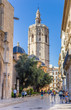 Tower and blue tiled domes of the historic cathedral in Valencia, Spain