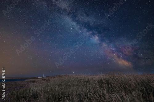 Foto op Aluminium Nachtblauw Vibrant Milky Way composite image over landscape of Lighthouse