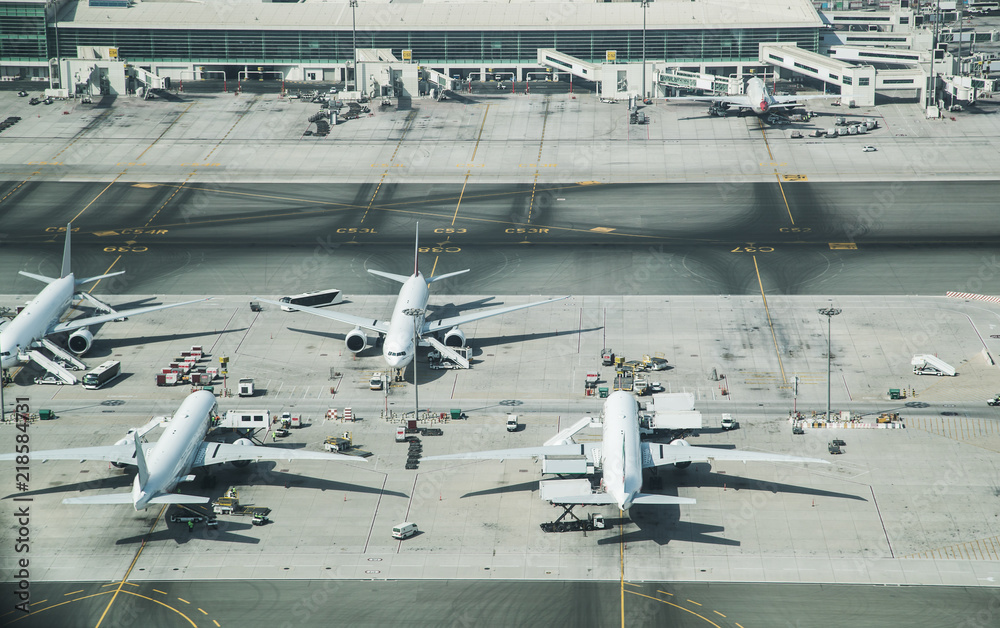 Fototapeta Aerial view of parked airplanes in the airport terminal.