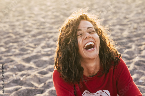 Obraz na plátně bright picture of laughing woman on the beach