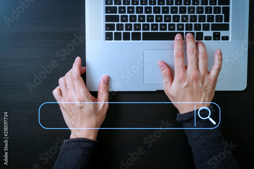 cyber security internet and networking concept.Businessman hand working with laptop computer