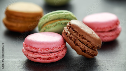 Foto auf Gartenposter Macarons Sweet colorful macarons dessert, almond cake, cookies. selected focus.