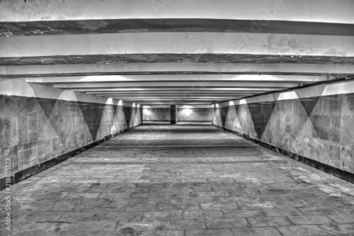 Fényképezés  The underground passage lined with gray granite and marble