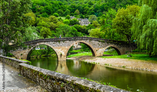 Belcastel medieval bridge with Aveyron river and green forest background , Aveyr Canvas Print