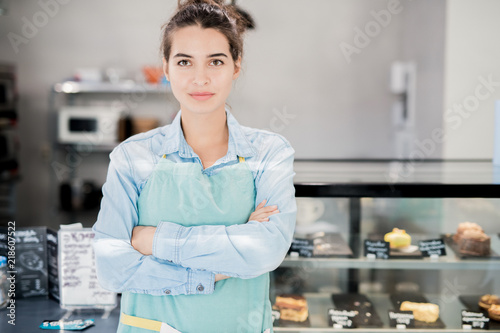 Fotografie, Obraz  Waist up portrait of modern female shopkeeper posing confidently standing with a