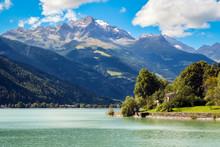 View On The Lovely Lago Di Poschiavo (Graubunden, Switzerland). Poschiavo Is A Municipality In The District Of Bernina In The Canton Of Graubünden In Switzerland