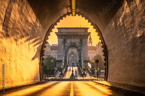 Aluminium Prints Budapest Budapest, Hungary - Entrance of the Buda Castle Tunnel at sunrise with Szechenyi Chain Bridge and Academy of Science building at background
