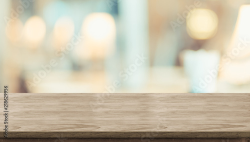 Empty rustic wood table and blurred soft light table in restaurant with bokeh background. product display template.Business presentation.