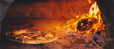 pizza in the oven, panoramic view - 218633582