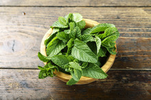 Fresh Mint In A Wooden Plate