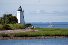 Sailboat Passing By Black Rock Harbor Lighthouse In Connecticut