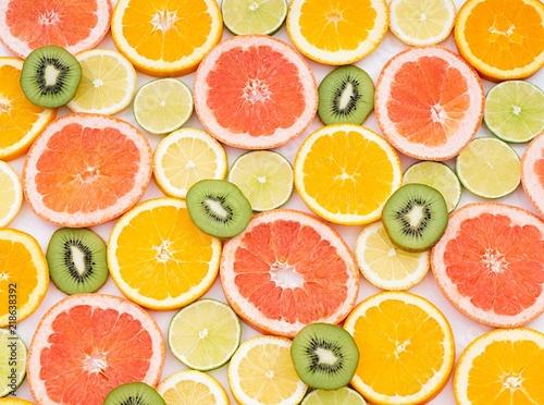 Fotografie, Tablou oranges ,grapefruit, and other fruits sliced