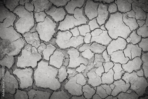 Foto  Closeup of dry soil, Cracked Ground Background