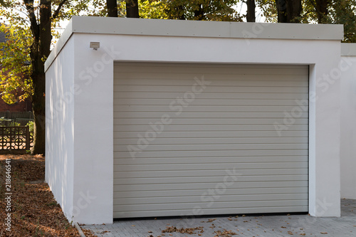 Fototapeta modern new white garage with roller shutter obraz
