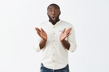 Clasping Hands From Surprise And Amazement. Impressed Good-looking African American Male Coworker In Stylish Buttoned Shirt, Spreading Palms And Folding Lips From Astonishment, Being Fascinated