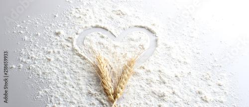 Fototapeta flour heart spikelets on a light background obraz