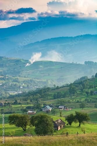 Foto op Canvas Herfst Beautiful carpathian village on a mountain hill