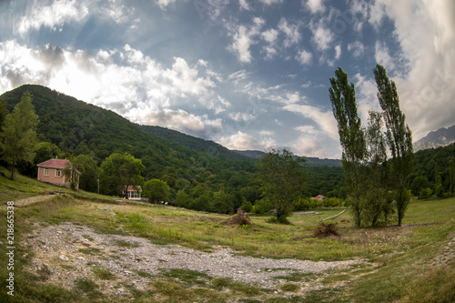 Beautiful landscape of mountains and forest with buildings at summer