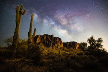 A Starry Night Time Desert Landscape With The Milkyway.  Milkyway Rising Behind The Superstition Mountains. Arizona