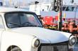 old russian car wreck in an shipyard
