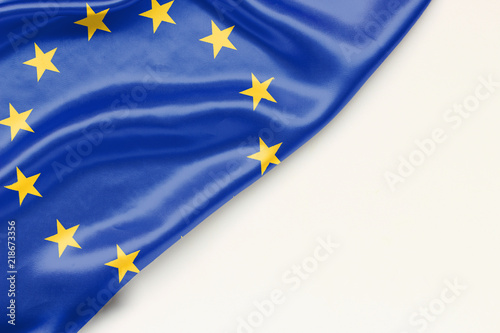Foto  Flag of the European Union: white background and place for text