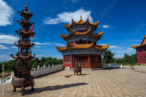 Chinese pagoda, religious temple architecture near to the city of Jingzhou, Hunan Province China. Feishanzhai, colorful Chinese architecture with bright red, and orange and blue painted colors.