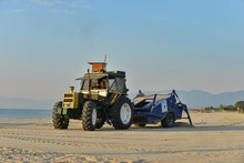 Tractor Cleaning The Beach On ...