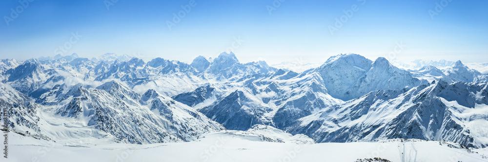 Fototapety, obrazy: Snowy Greater Caucasus ridge with the Mt. Ushba at winter sunny day. View from Pastuchova kliffs at Elbrus ski slope, Kabardino-Balkaria, Russia