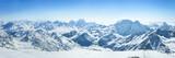 Snowy Greater Caucasus ridge with the Mt. Ushba at winter sunny day. View from Pastuchova kliffs at Elbrus ski slope, Kabardino-Balkaria, Russia