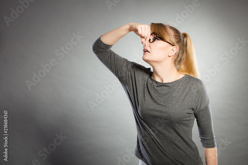 Fotografie, Tablou  Nerdy girl holding nose.