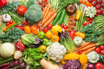 Assortment of fresh colorful organic vegetables on wooden pine table, healthy food background, top view, selective focus