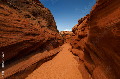 Fotobehang Bruin Scenic colorful canyon landscape with beautiful clouds in the sky. Beauty of American southwest. Slot canyon in Page, Arizona