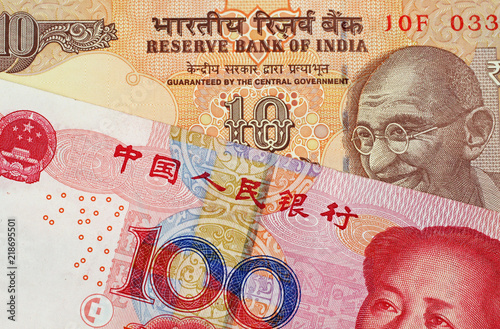 Valokuvatapetti A close up image of a 100 Chinese yuan bank note with a 10 Indian Rupee bank not