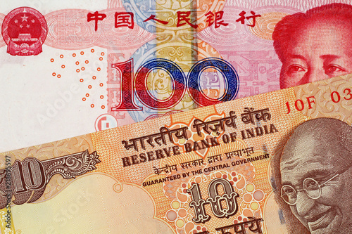 Fotografie, Obraz  A close up image of a 100 Chinese yuan bank note with a 10 Indian Rupee bank not