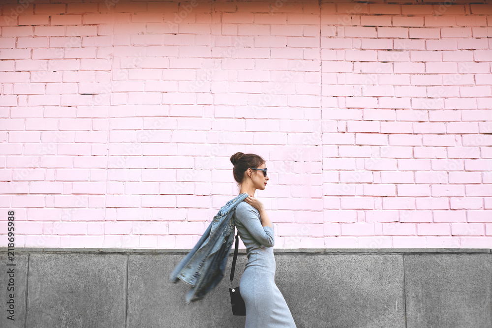 Fototapety, obrazy: Street Style Shoot Woman on Pink Wall. Swag Girl Wearing Jeans Jacket, grey Dress, Sunglass. Fashion Lifestyle Outdoor