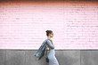 canvas print picture - Street Style Shoot Woman on Pink Wall. Swag Girl Wearing Jeans Jacket, grey Dress, Sunglass. Fashion Lifestyle Outdoor