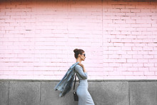 Street Style Shoot Woman On Pink Wall. Swag Girl Wearing Jeans Jacket, Grey Dress, Sunglass. Fashion Lifestyle Outdoor