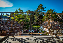Wrought Iron Fence On Old Balcony, Shadows Of The Sun