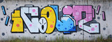 Fototapeta Młodzieżowe - Full and acomplished graffiti artwork. The old wall decorated with paint stains in the style of street art culture. Colored background texture