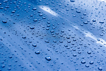 Water Drops On A Metalic Grey Car Background