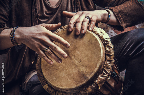 Ethnic percussion musical instrument jembe and male hands