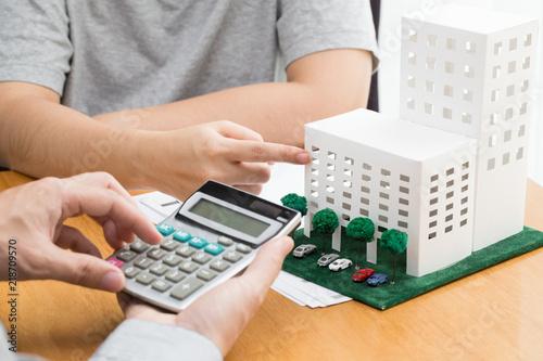 Fotografía  condominium and home loan interest rates from bank concept