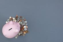 Gray Desktop With Piggy Bank A...