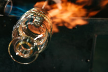 A Glassmaker Fires A Decanter