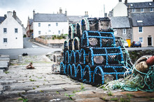 Lobster Pots On Scottish Wharf