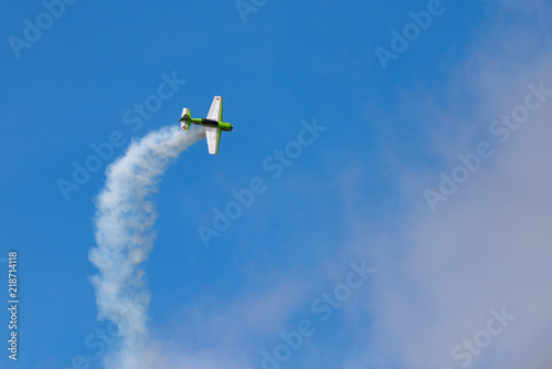 Tela  Long angle view of Yak-54 in the sky performs the program at the air show