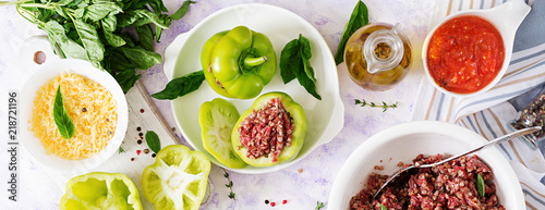 Fototapeta Ingredients for preparation of stuffed pepper with minced meat and buckwheat porridge. Tasty food. Flat lay. Top view. Banner obraz