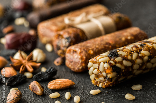 Poster Pays d Asie Homemade energy bars with figs Dried apricots, raisins, dates, figs, pine nuts, almonds, walnuts . healthy snack . copy space