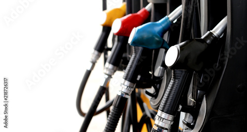 red green yellow orange color fuel gasoline dispenser  background energy crisis Fototapet
