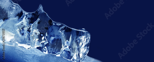 Xmas decorative template background. Textured frozen ice on blue. Abstract frozen water shape macro view. Shallow depth of field, copy space